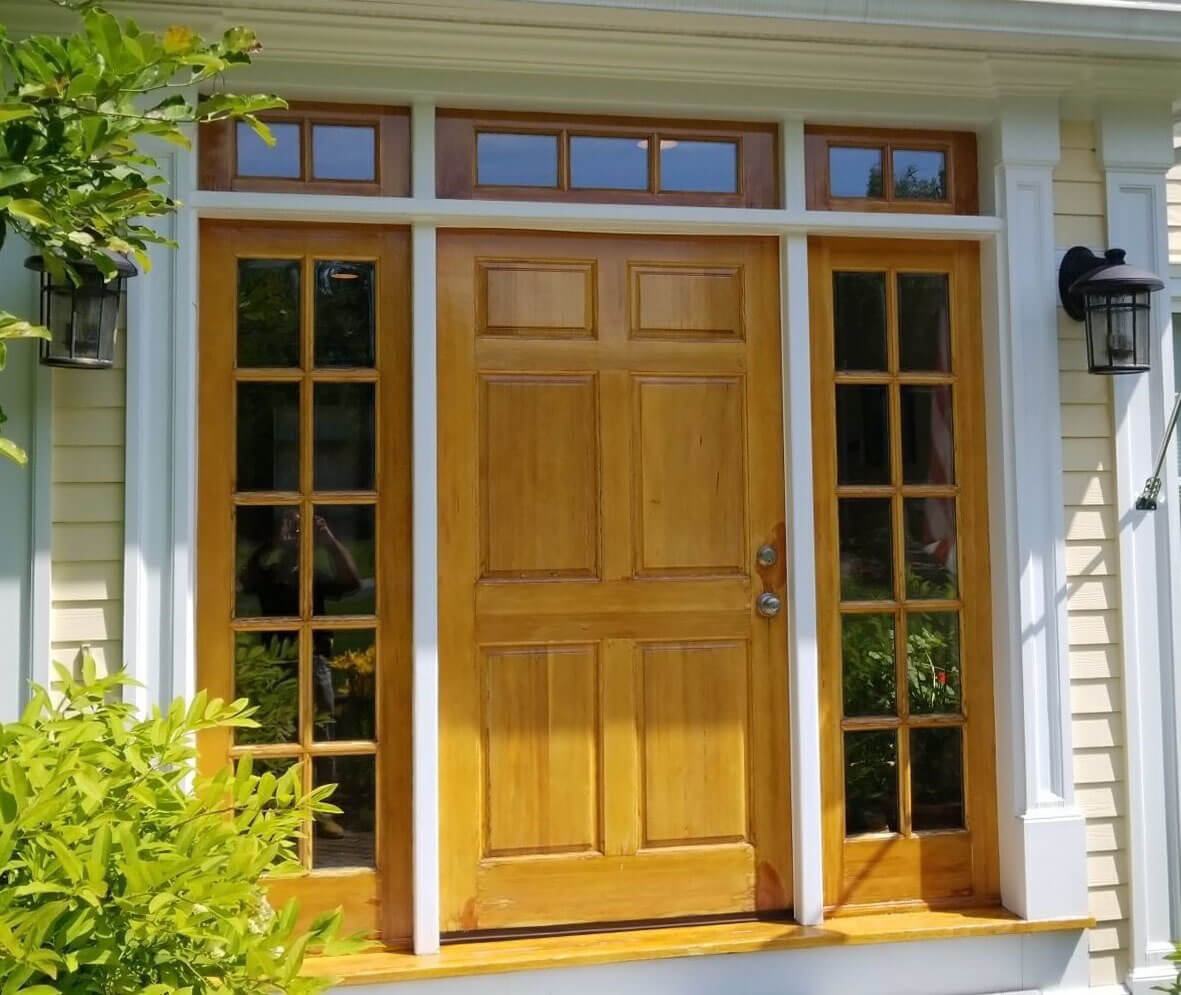 Wooden door with glass panels