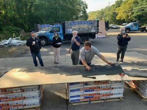 Man holding roofing training